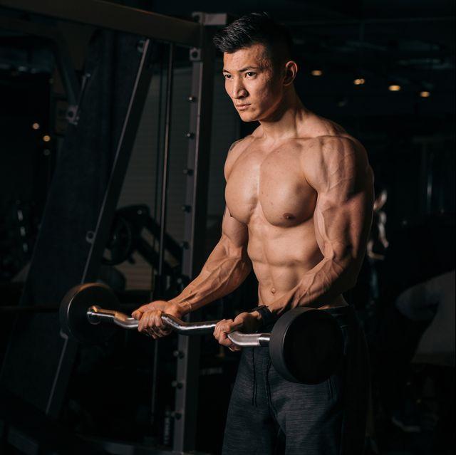 shirtless asian bodybuilder exercising