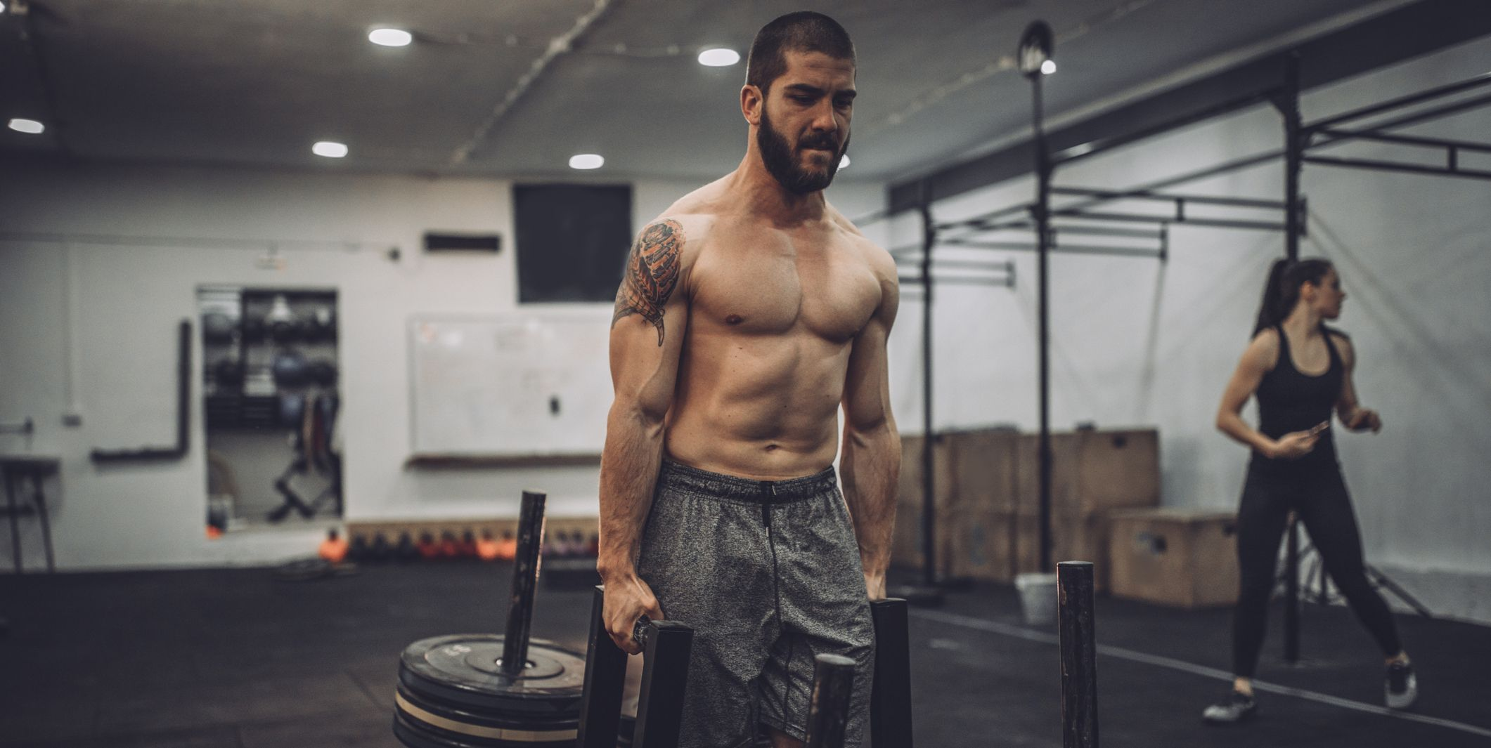 Shirtless man training hard