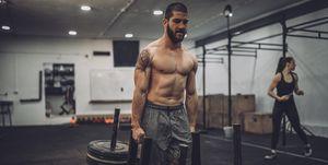 Shirtless man training hard