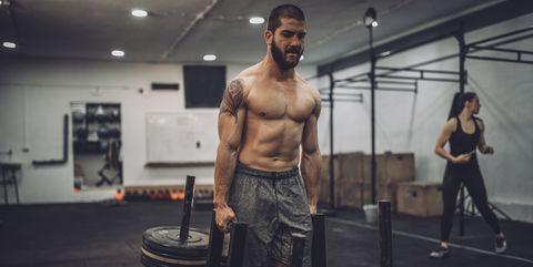 4639ebadfc Shirtless man training hard