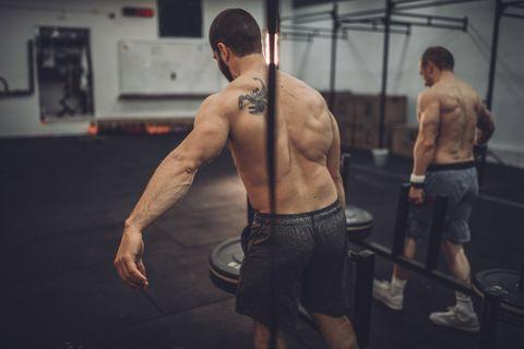 Shirtless men training hard