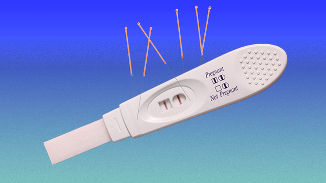 a pregnancy test with acupuncture needles sticking out of it