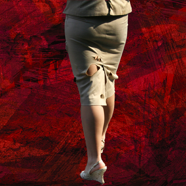 woman in ripped skirt with high heels in front of red background