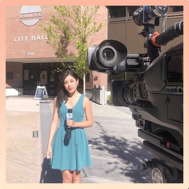 broadcast journalist erika lee sets up for a live tv shot outside of the boise city hall