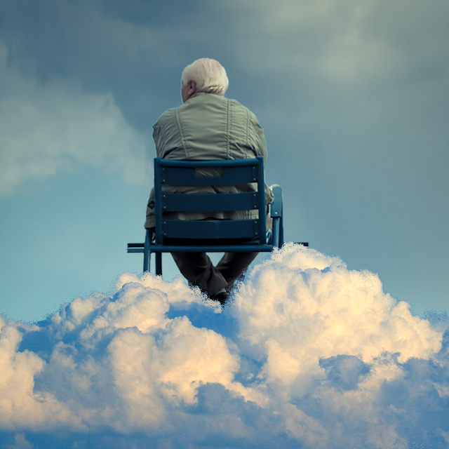 older man in wheelchair on top of clouds