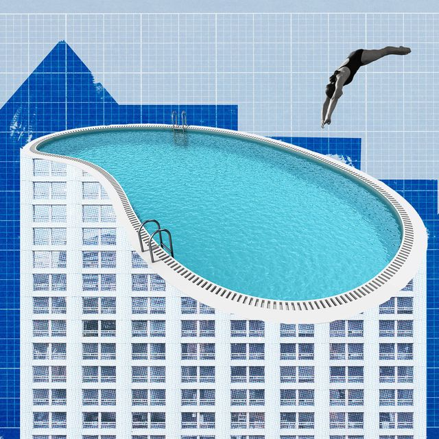 woman diving into a pool over building