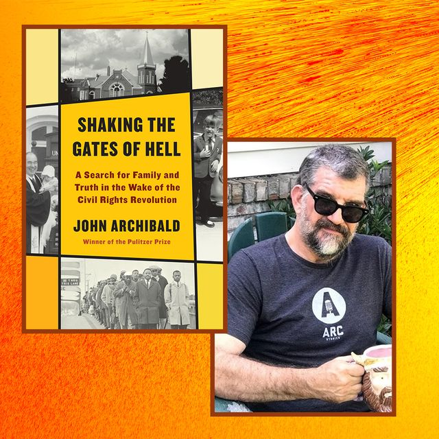 writer john archibald poses next to a copy of his book, shaking the gates of hell