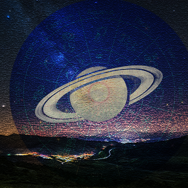 saturn and zodiac wheel over mountains