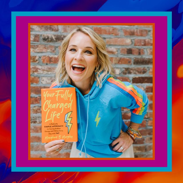 meaghan murphy holding a copy of your fully charged life
