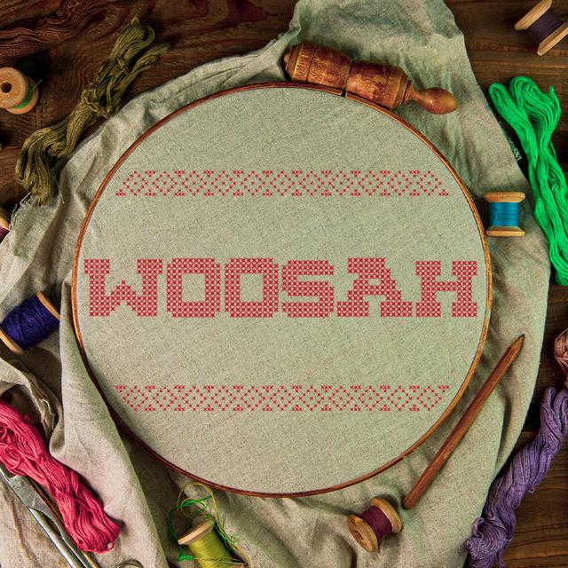 needlepoint with woosah printed on it