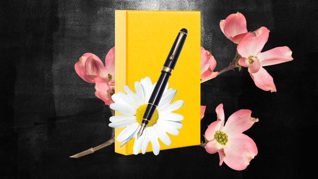 a journal, pen, and flowers
