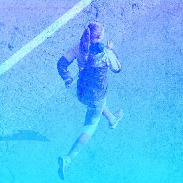 girl running blue background overlay