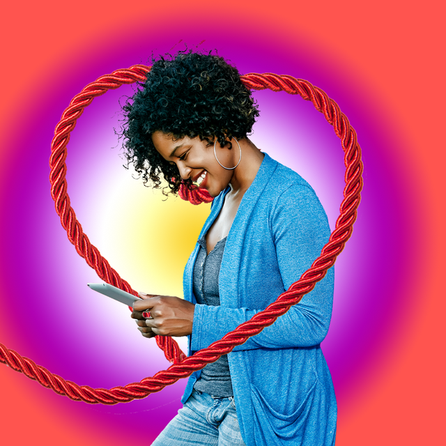 woman happy on phone red rope colorful background