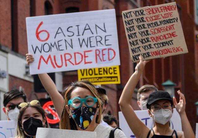 women protesting shooting of asian women
