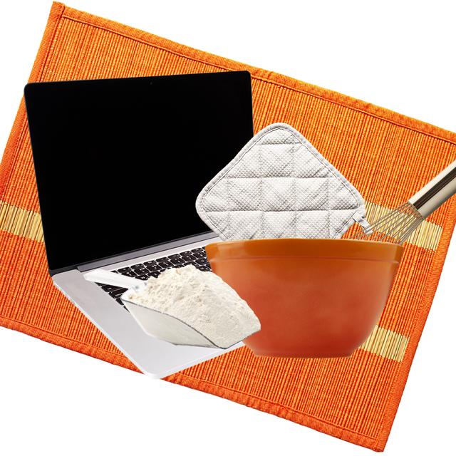 computer, flour, potholder, bowl, whisk on orange background