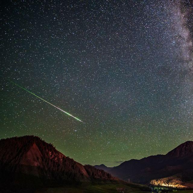 meteor streaking across night sky