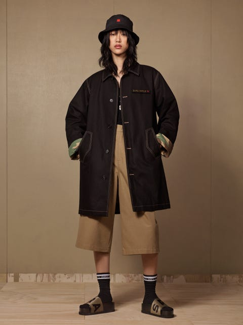 Clothing, Outerwear, Coat, Overcoat, Standing, Fashion, Trench coat, Duster, Fashion model, Knee,