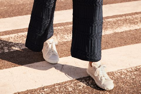 White, Footwear, Leg, Human leg, Ankle, Shoe, Fashion, Infrastructure, High heels, Shadow,