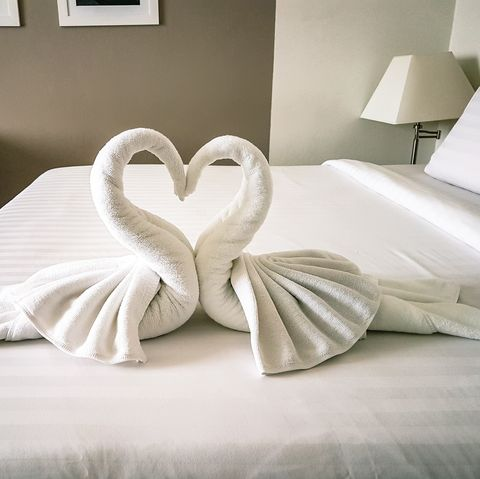 Shot of hotel room towels in swan shapes, towel art, maid service