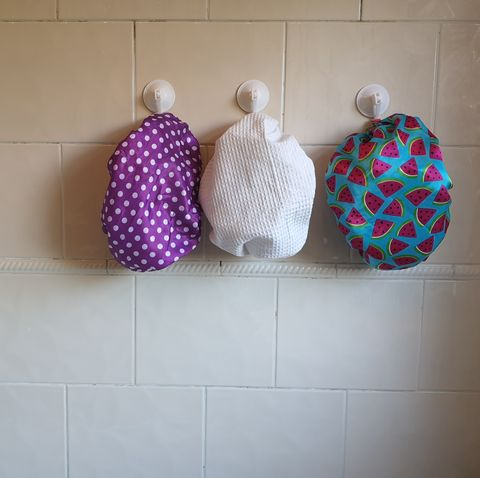 shower caps hanging on wall at home
