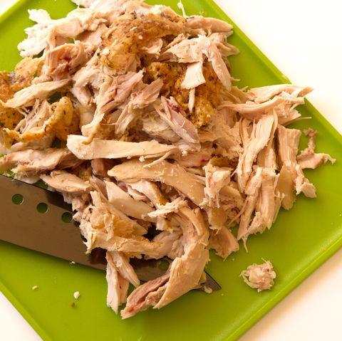 Shredded rotisserie chicken isolated on a white background