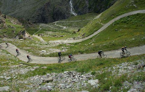 cyclists riding up mountain pass