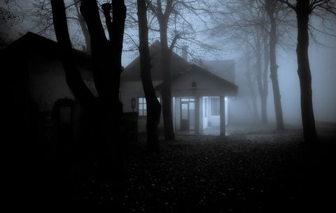 Creepy house surrounded by fog