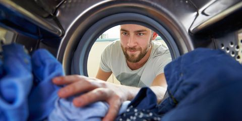man loading laundry