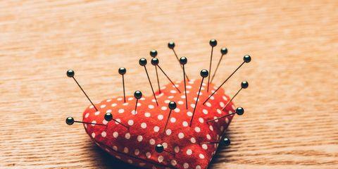 Pins in heart pincushion