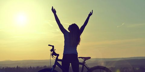 silhouette of excited bike rider