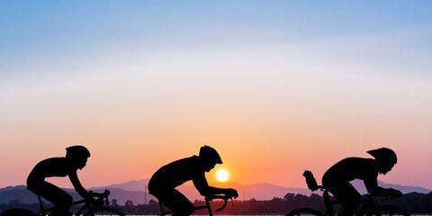 cyclists at sunrise
