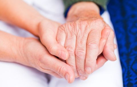Holding hands with elderly