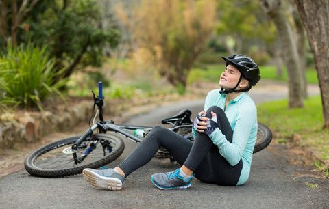 woman next to bike with sore leg