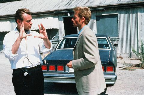 "christopher nolan and guy pearce on the set of ""memento"" in 2000"