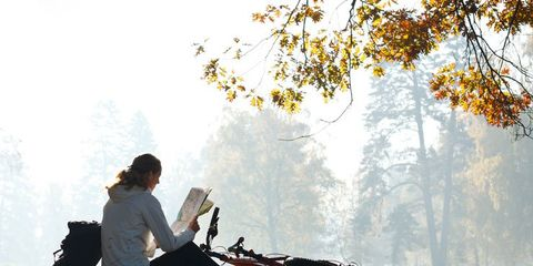 woman reading near bike