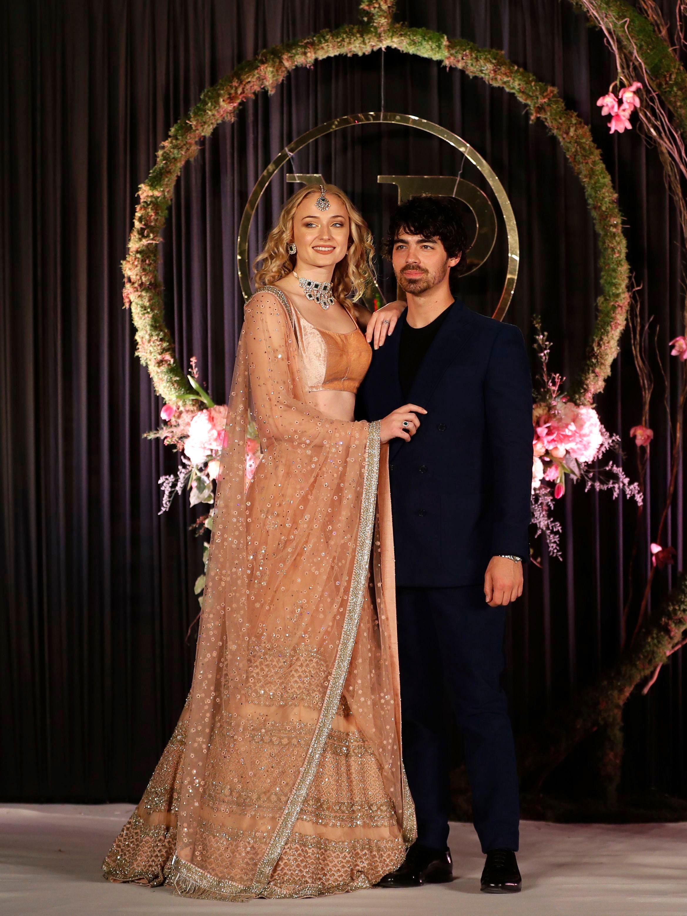 See Sophie Turners Reception Dress For Nick Jonas And Priyanka