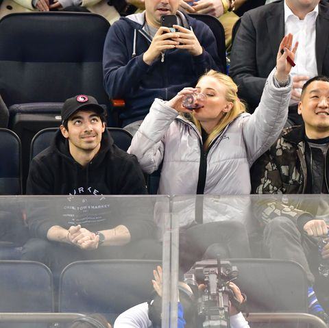 Facial expression, Fan, Selfie, Photography, Gesture, Outerwear, Crowd, Finger, Competition event, Tennis,
