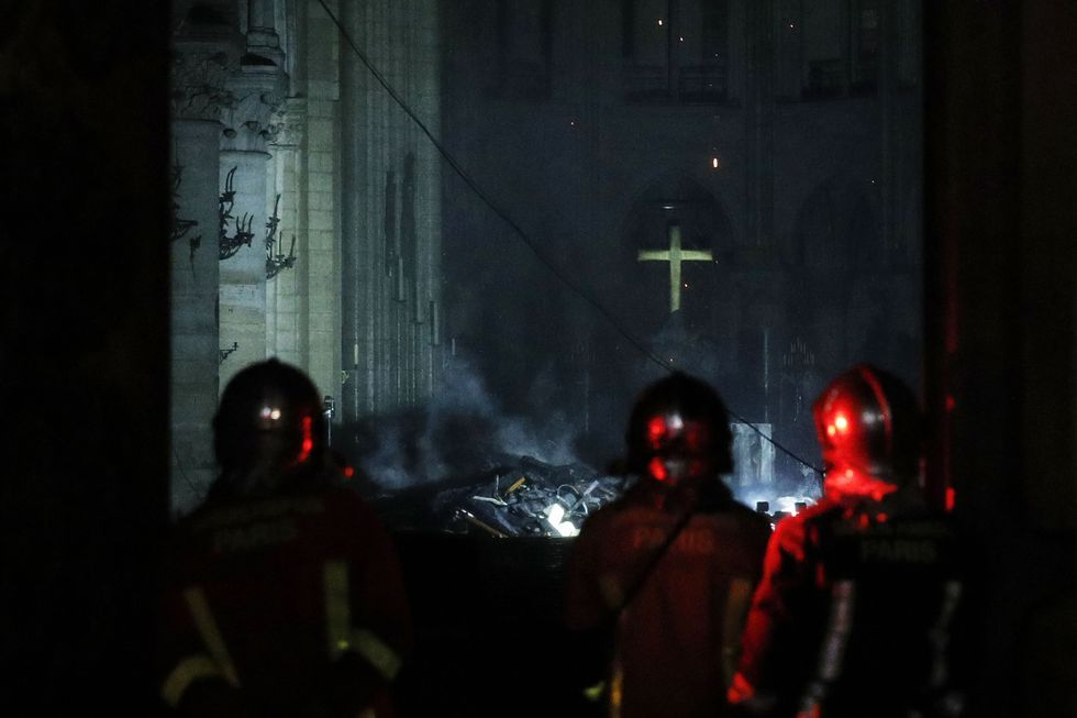 notre dame cathedral fire fighters damage after fire