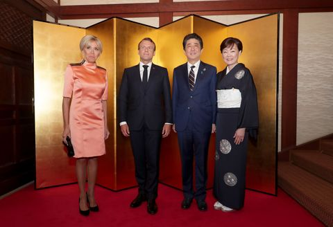 Japanese Prime Minister Shinzo Abe and his wife Akie Abe welcoming French President Emmanuel Macron and wife Brigitte Macron at the Cultural Program and Leaders' Dinner welcome and photo session at the Osaka Geihinkan guest house during the G20 summit, in Osaka, Japan, 28 June 2019.