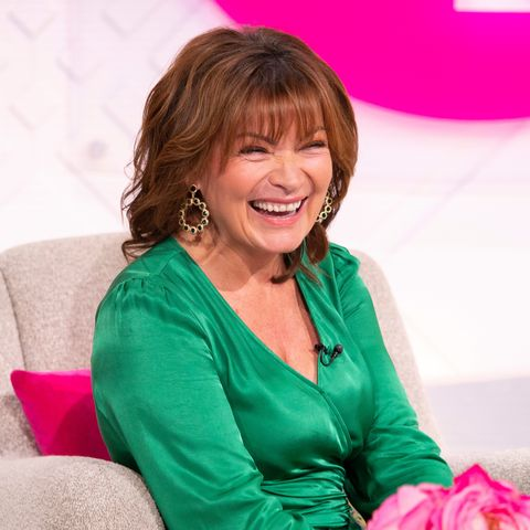 Lorraine glams up in green satin dress for anniversary show