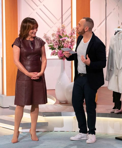 Lorraine Kelly works the leather trend with stylish burgundy dress