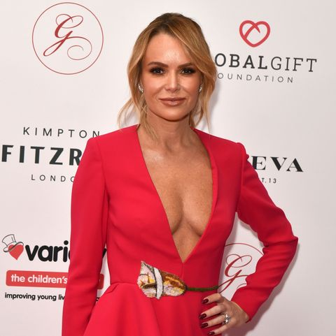 Amanda Holden poses in crutches after breaking leg