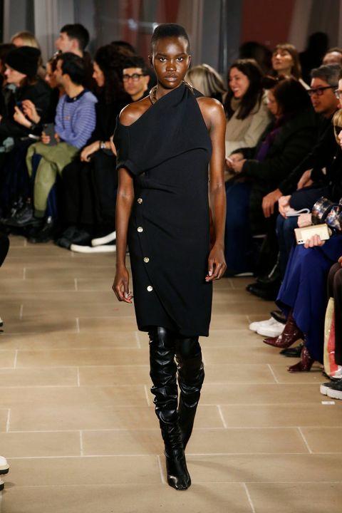Fashion model, Runway, Fashion, Fashion show, Shoulder, Dress, Event, Fashion design, Haute couture, Joint,