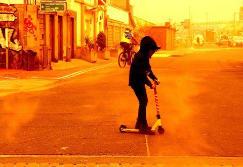 Yellow, Skateboard, Evening, Sunlight, Fun, Shadow, Skateboarding Equipment, Recreation, Sports equipment, Street,