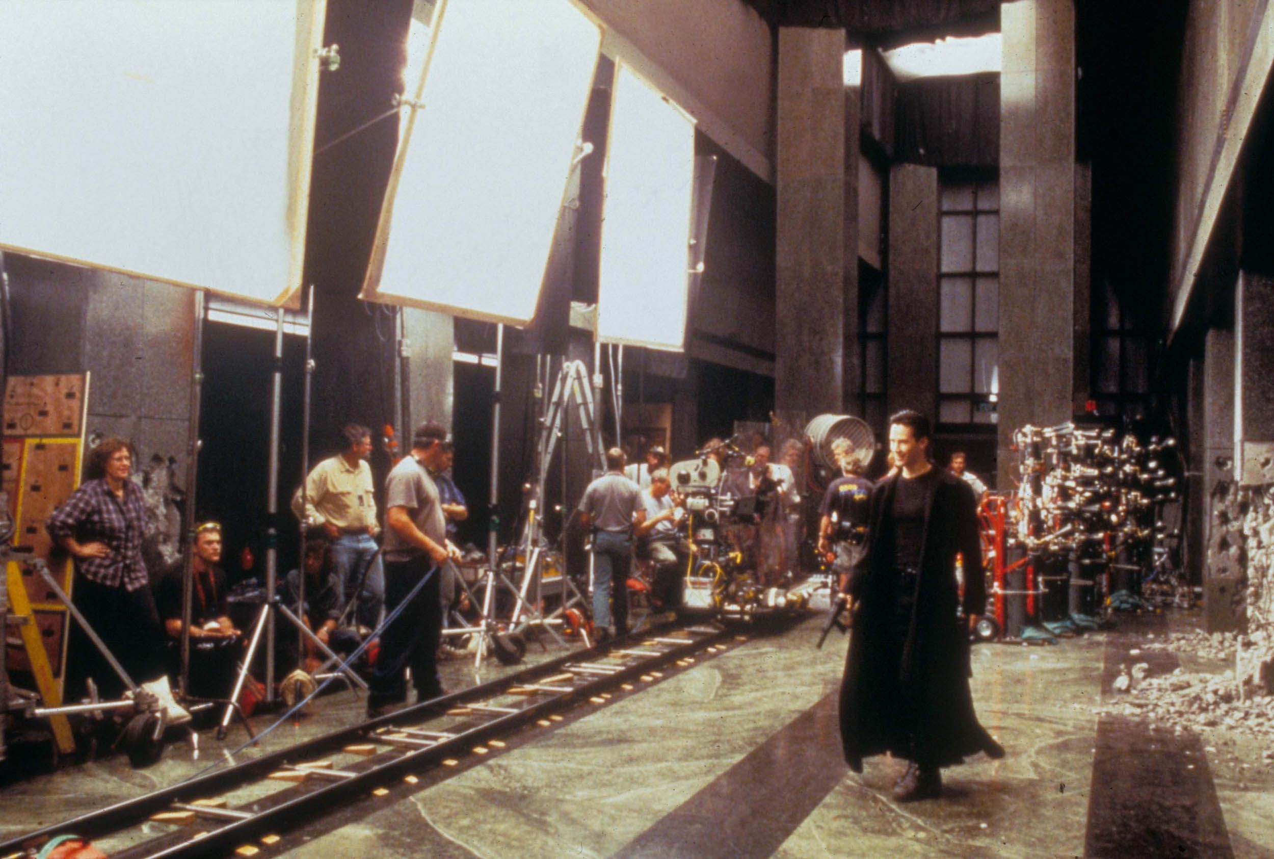 Keanu Reeves shooting a scene in the 1999 film The Matrix .