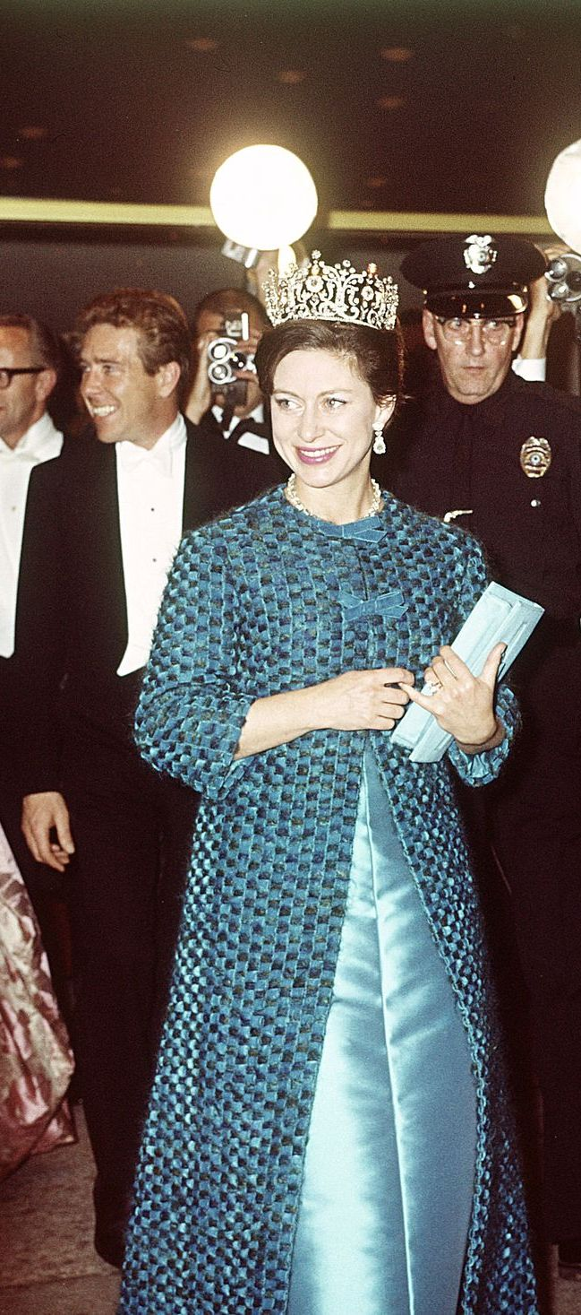 In 1965, Princess Margaret wore a blue dress and coat with a stunning tiara during a visit to America. The Princess attended an event at the Hollywood Palladium in Los Angeles with Lord Snowdon.