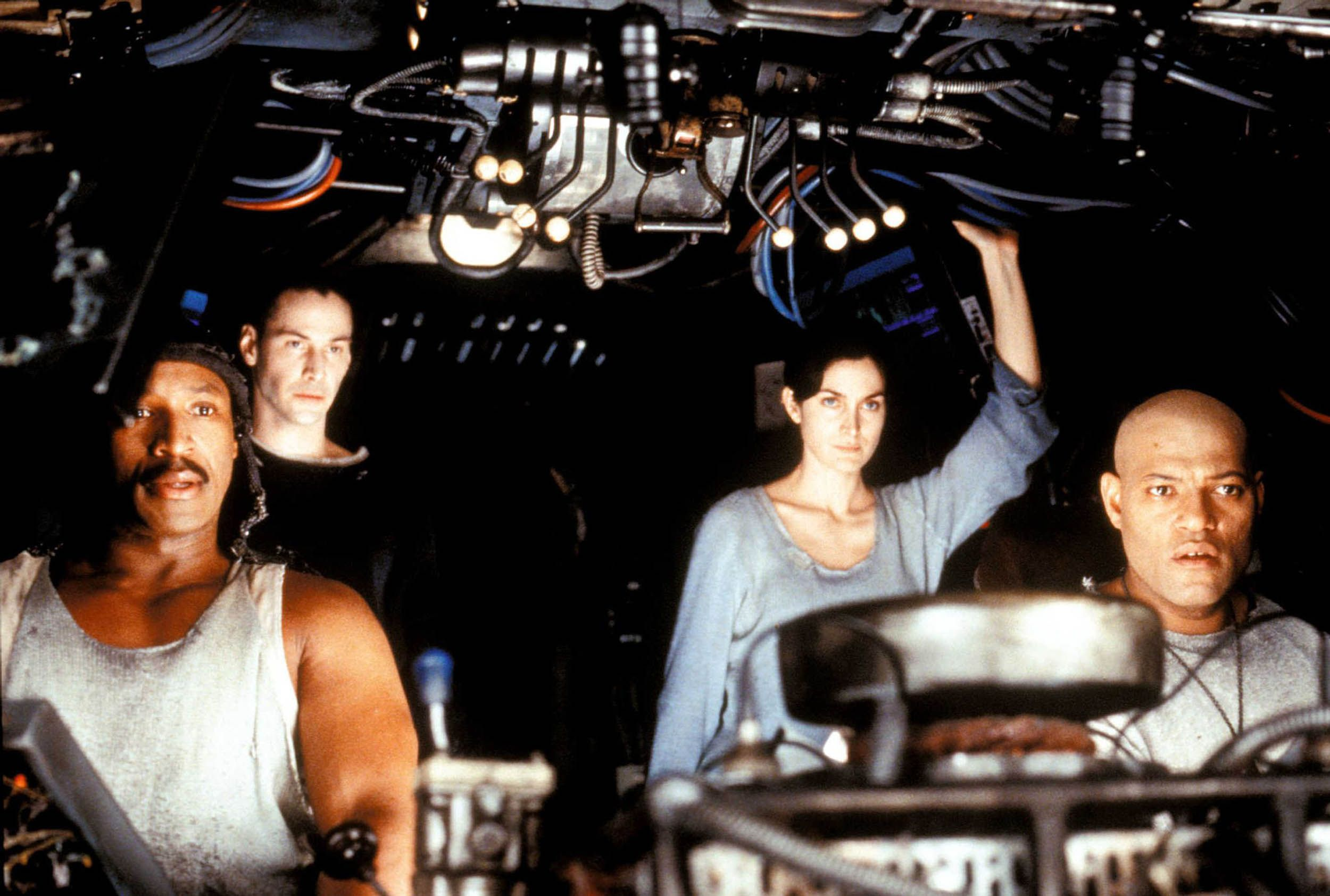 Anthony Ray Parker, Keanu Reeves, Carrie-Anne Moss and Laurence Fishburne in the 1999 film The Matrix.