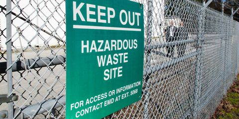 Text, Street sign, Font, Signage, Chain-link fencing, Sign, Fence, Wire fencing,