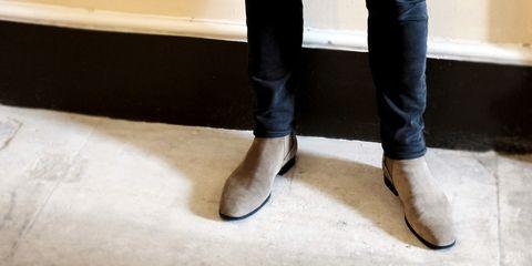 Footwear, Black, Shoe, Jeans, Leg, Brown, Floor, Human leg, Boot, Leather,