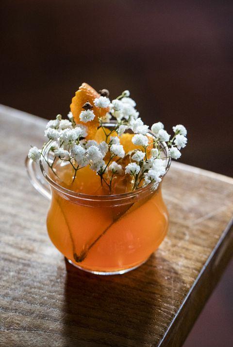 Orange, Food, Still life photography, Cuisine, Plant, Flower, Fashion accessory, Dish,